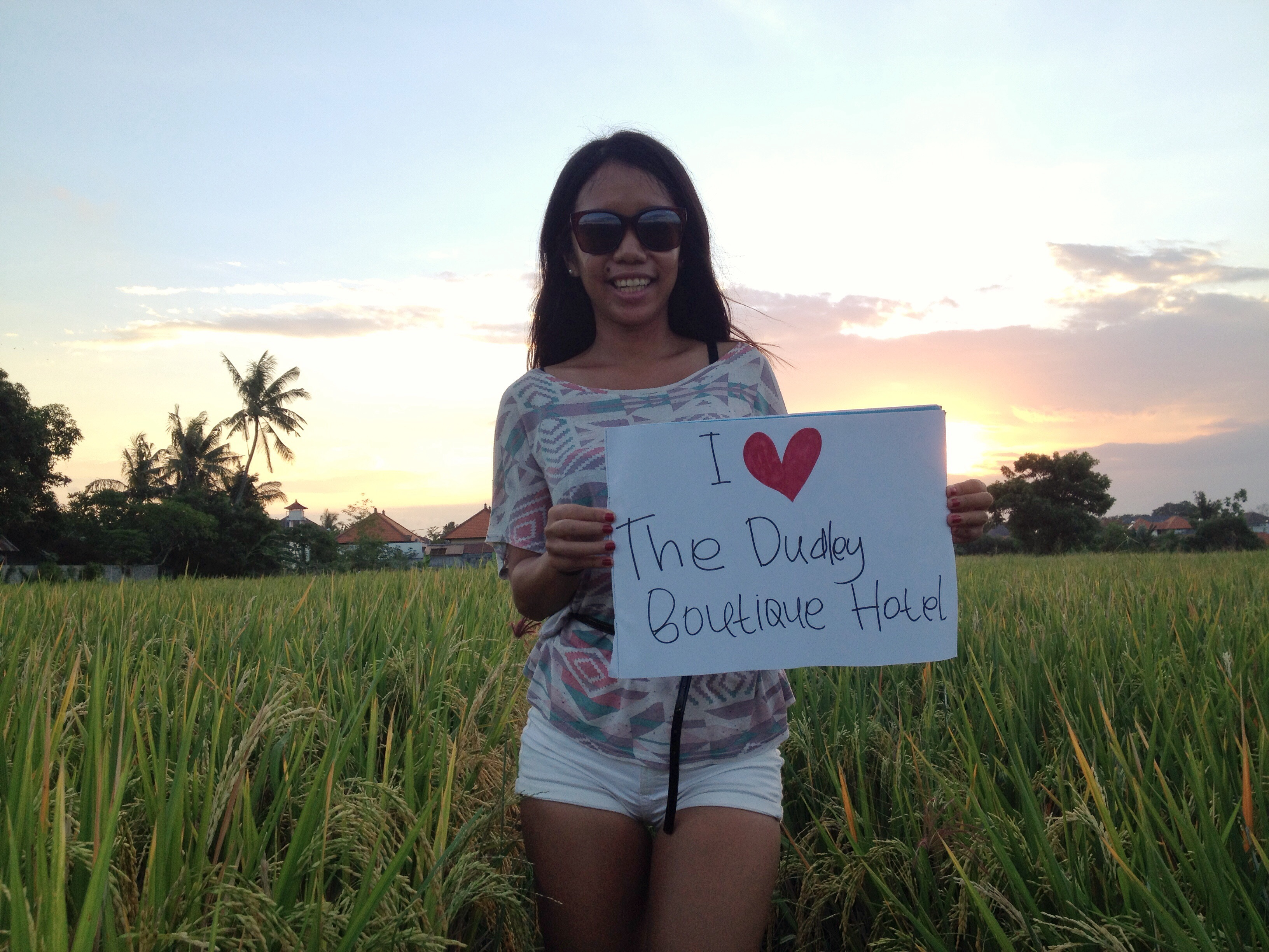 Hold a sign in beautiful place in bali